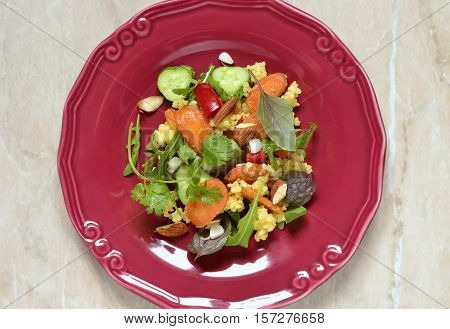 Moroccan salad: carrots millet herbs pepper, top view
