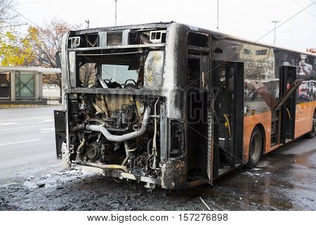Sofia, Bulgaria - November 8, 2016: Burnt public traffic bus is seen on the street after caught in fire during travel and extinguished by firefighters.