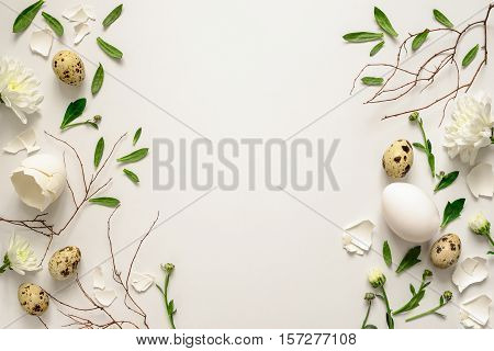 Easter floral background various eggs end egg shell decorated with natural botanical elements flat lay view from above blank space for greeting text