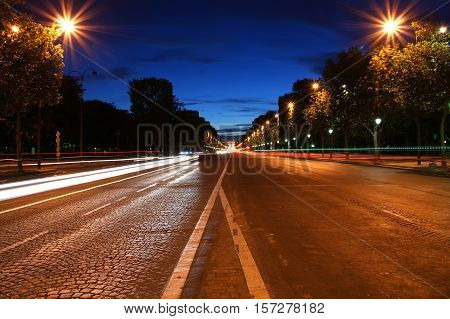 Champs-elysees Avenue At Night With The Triumphal Arch In The Background, Paris, France