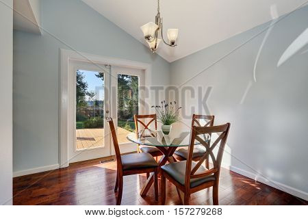 Pastel Blue Walls And Vaulted Ceiling Of American Dining Room