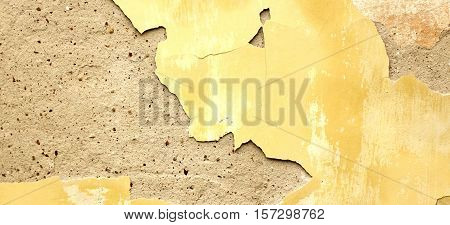 Dark Plaster Wall With Dirty Yellow Scratched Horizontal Background. Old Brickwall With Peel Swamp Color Stucco Texture. Retro Vintage Worn Concrete Wall Surface. Decay Crack Rough Abstract Banner