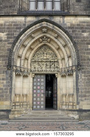Entrance portal of the church on Vysehrad in Prague with sculpture of the Last Judgment