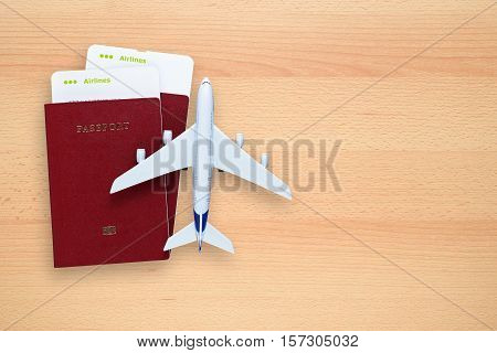 Boarding passes passports and toy aircraft on desk