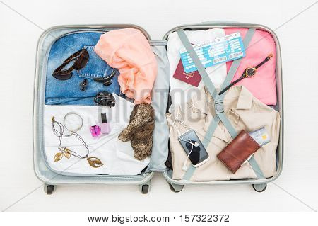 travel traveler traveling bag top open view packing card camera packed credit wallet clothing table leaving departure concept - stock image