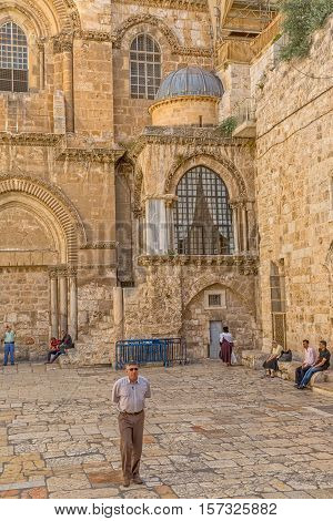 JERUSALEM, ISRAEL - JUNE 19, 2015: Tourists and pilgrims at the atrium of the Church of the Holy Sepulchre, holiest Christian site in the world.