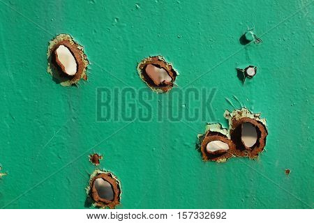holes from shrapnel in the metal war