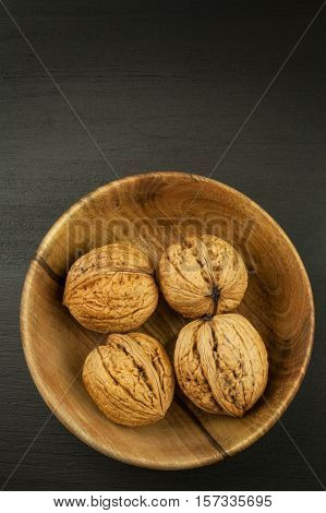 Super foods for human brain. Nuts on a wooden table. Walnuts