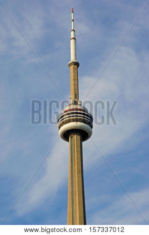 A closeup image of the top part of the CN tower of Toronto.
