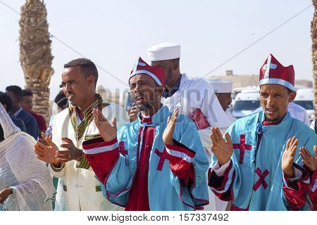 JERICHO, ISRAEL - NOV 12, 2016: Ethiopian pilgrims in ritual clothes clap hands while singing during a visit of Qasr el Yahud the Baptismal site on Jordan river.