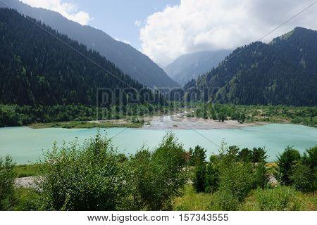 Big Almaty Lakeat the Ile-Alatau National Park near Almaty Kazakhstan on summer afternoon.