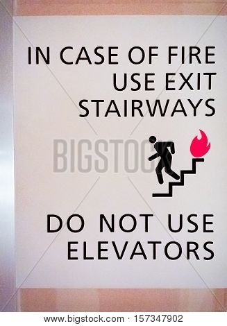 Emergency Fire Signage - For occupants to use escape stairways only, and not elevators.