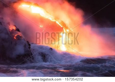 Molten lava flowing into the Pacific Ocean on Big Island of Hawaii