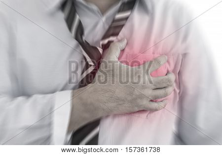 Front view of a businessman with cardiology (heart disease) red around the area of pain.
