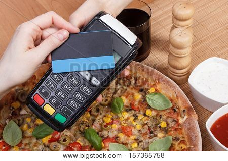 Using Payment Terminal With Contactless Credit Card For Paying In Restaurant, Finance Concept, Veget