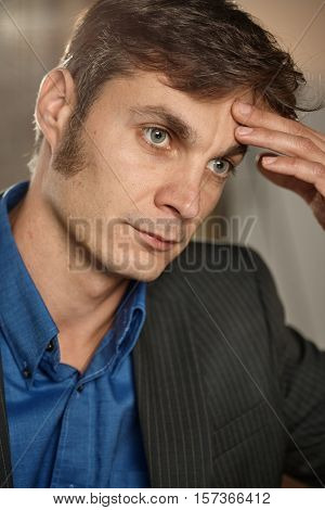 Portrait of daydreaming businessman.