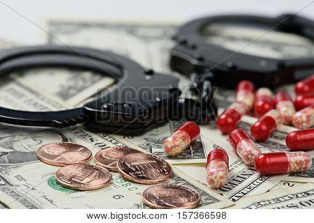 Handcuffs, Money And Pills