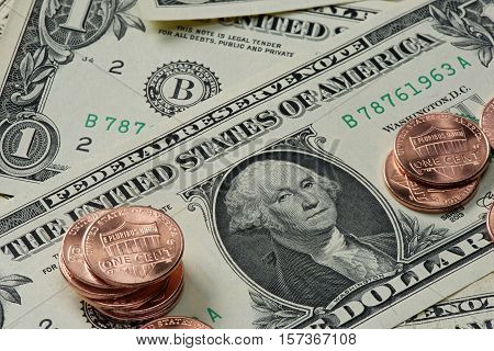 One Cent Coins And Dollar Banknotes