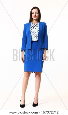 brunette business executive woman with straight hair style in official two pieces skirt jacket suit high heels shoes stand full body length isolated on white