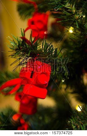 red Christmas toy in a feed of the camera cards for the photographer at Christmas and new year