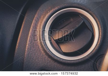 Close up shot of the air vent from a car.