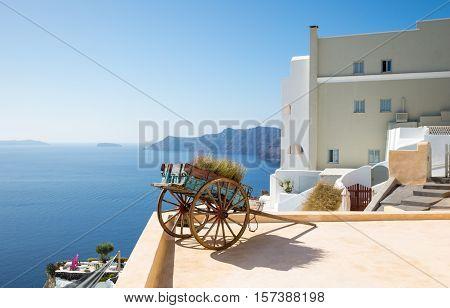Greece Santorini island Oia a traditional handcart on a terrace