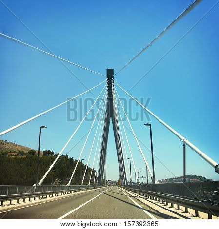 Car road on cable-stayed bridge, summer time