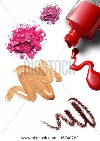 cosmetics: nail polish, foundation, crushed eye shadow. white background, isolated objects