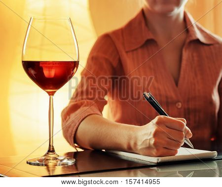 Wine Tasting. Sommelier Making Notes In Notebook