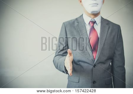 Business Man Giving Dishonest Handshake Hiding In The Mask - Business Fraud And Hypocrite Agreement
