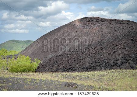 Close up on of the crater of Cerro Negro volcano near Leon in Nicaragua popular for volcano boarding. Its slippery slopes of lava sand ash and rocks are hard to ascend and descend