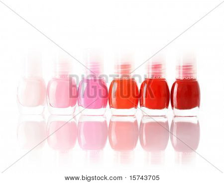 red and pink nail polish bottles on white background