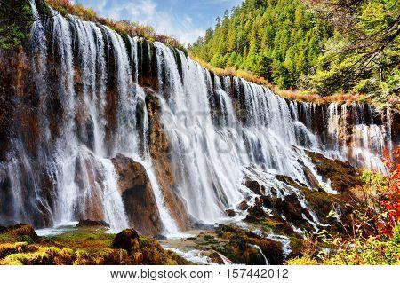 Fantastic View Of The Nuo Ri Lang Waterfall (nuorilang)