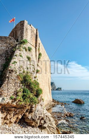 View of medieval citadel in Budva which was mentioned for the first time in chronicles in 1425. Copy space in sky.