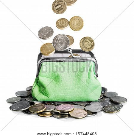 green purse and coins isolated on white. Coins falling into a purse