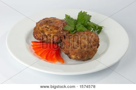 Cutlets With Tomato And Parsley.