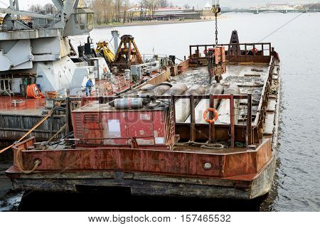 Work boat used in the conduct of industrial activities on the river.