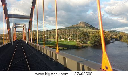 Railway bridge over the Elbe river in Czech Republic with nice sky and clouds