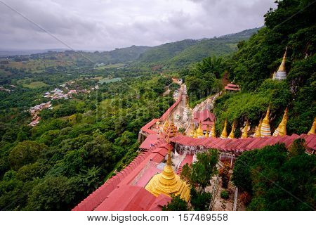 View Of Buddhist Gold Pagodas And Colorful Staircase To Pindaya Caves, Myanmar