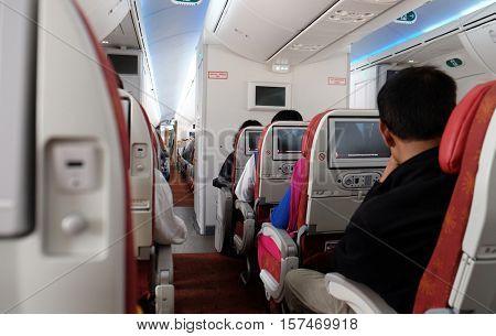 KOLKATA, INDIA - FEBRUARY 12: Airplane interior. Passengers waiting for taking off, Kolkata, India on February 12, 2016.
