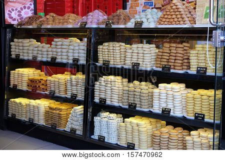 BEIJING - FEBRUARY 23: Sweets shops in Beijing in Nanluoguxiang hutong in Beijing, China, February 23, 2016.
