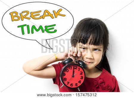 Asian little girl kid is upset and asking for a break time. Education concept on too much study can be stressed out for children.