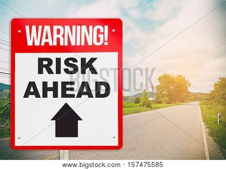 Warning sign on the road ahead say Risk Ahead. Business and risk management concept.