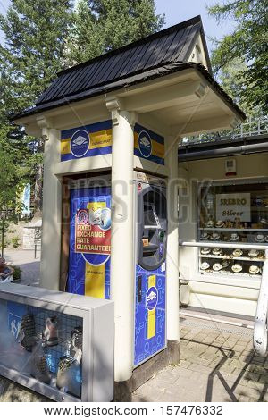 ZAKOPANE POLAND - SEPTEMBER 13 2016: ATM machine was placed on the street and was enclosed at the small construction which relates to the architectural style of the region