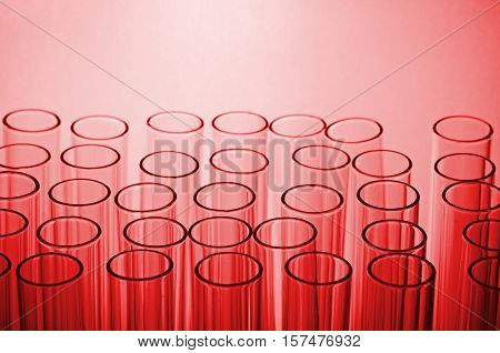 Science Laboratory Test Tubes In Red Tone