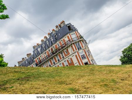 PARIS FRANCE - 28TH JULY 2016: A view of buildings in Montmarte Paris during the day. Taken at an angle that makes the building appear to be sinking
