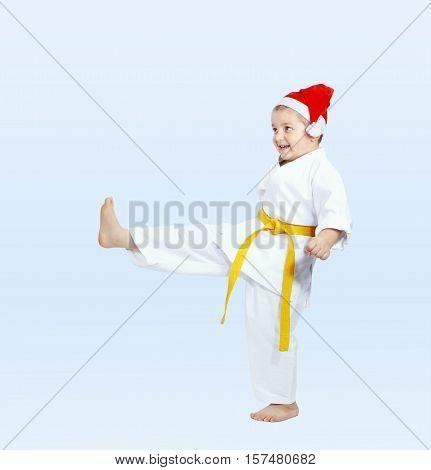 In cap of Santa Claus sportsman beats kicking