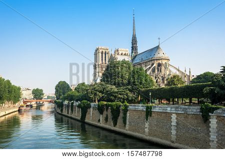 View of southern facade of Notre-Dame de Paris from the Seine river. Notre-Dame cathedral is a medieval catholic cathedral and finest example of french gothic architecture. Paris France.