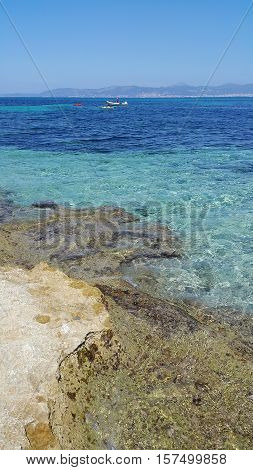 Beautiful sea views with boats and bright turquoise water Majorca Balearic Islands Spain