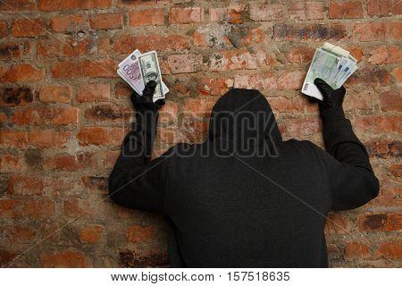 Burglar with money in hand